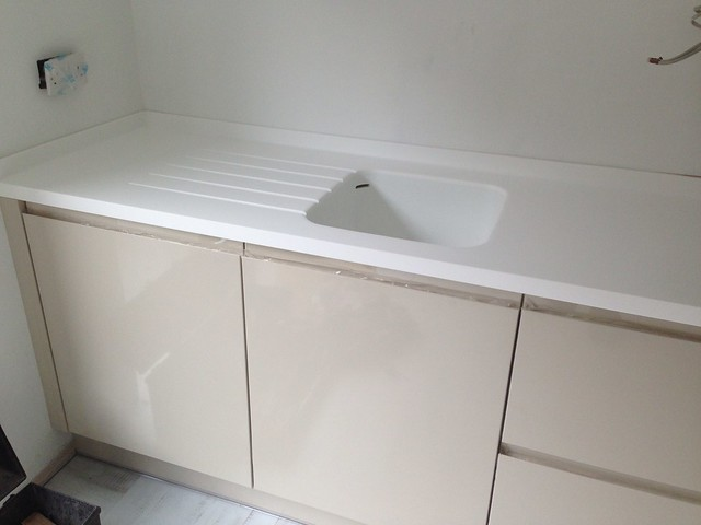 White corian seamless sink with inset draining grooves for Corian farm sink price