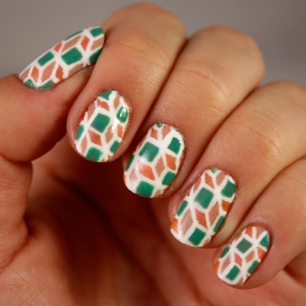 The first round of #r29nailartnation entries are up! Please visit ibittm.com/r29nan1 to vote for my design! #Notd #geometric #revlon #nailpolish #manicure #nailsofig #instamani #nailart #showusyourtips #beauty #nailpolishobsessed