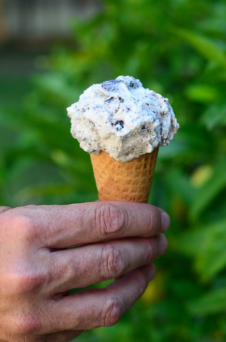 An ice cream cone made with Easy Homemade Cookies and Cream Ice Cream.