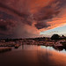 Stormy sunset over marina by JNickrand