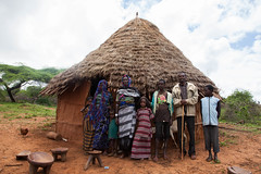 A pastoralist family in Borana poses infront of their house