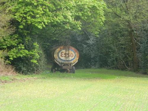 Old tanker in field