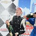 Mike Conway and Justin Wilson spray champagne