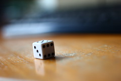 hand(0.0), recreation(0.0), number(0.0), indoor games and sports(1.0), yellow(1.0), white(1.0), sports(1.0), macro photography(1.0), tabletop game(1.0), games(1.0), close-up(1.0), dice(1.0), board game(1.0),