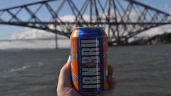 "Irn-Bru is a Scottish carbonated soft drink, often described as ""Scotland's other national drink"" (after Scotch whisky). It is produced in Westfield, Cumbernauld, North Lanarkshire, by A.G. Barr of Glasgow, since moving out of their original Parkhead factory in the mid-1990s, and at a seco..."