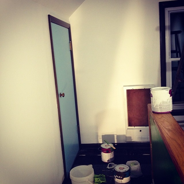 Getting there...just a couple more coats on the baseboards and a coat of chalkboard paint on the green half wall.