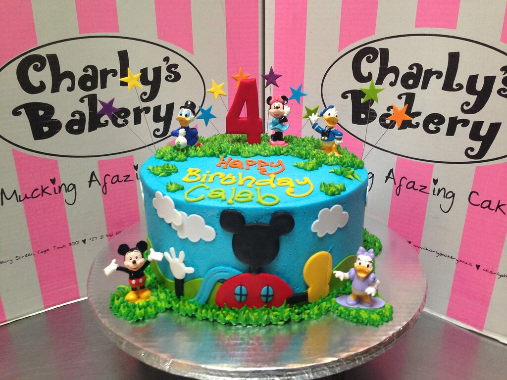 Mickey Mouse Clubhouse Friends Themed 4th Birthday Cake With 2D On Front Side Of 3D Toy Figurines Placed
