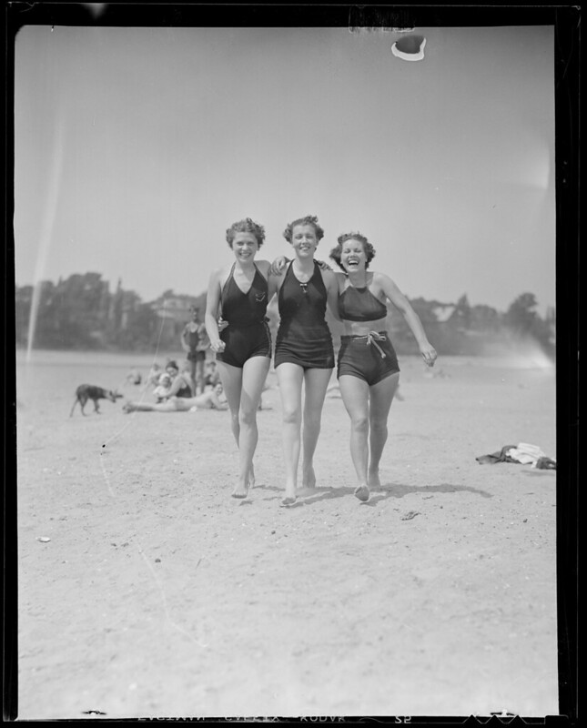 Three women sporting the latest styles at the beach