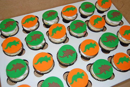orange brown and green dinosaur cupcakes