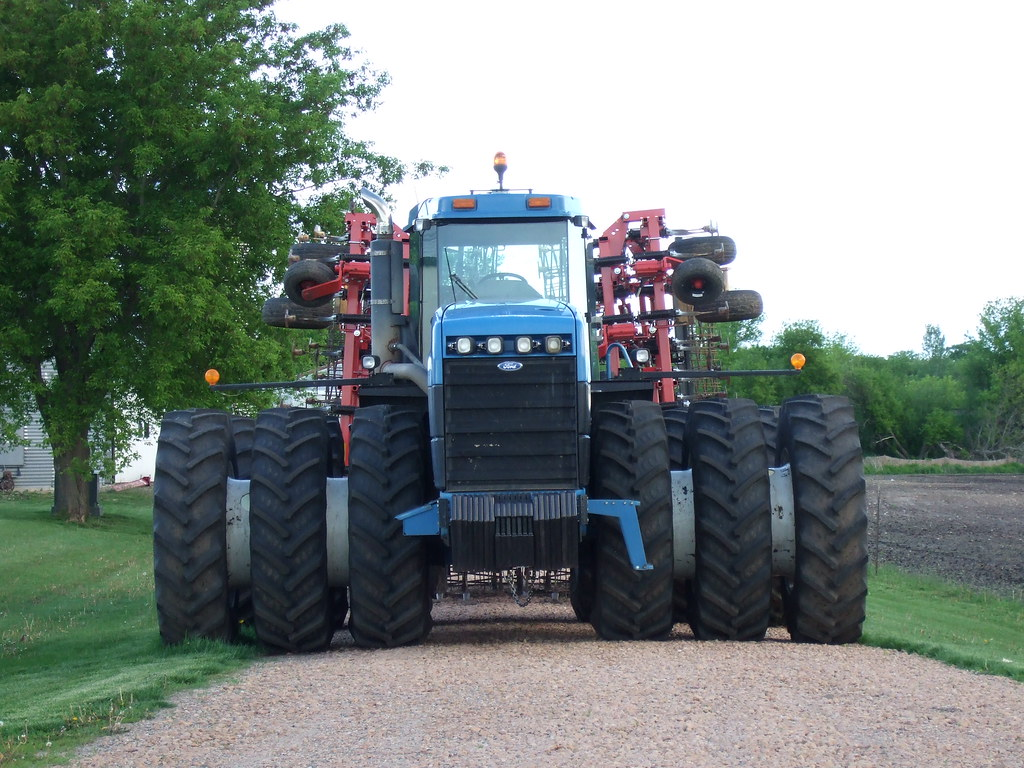 Large Ford four wheel drive tractor with triples