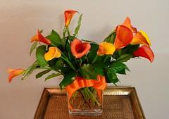 lily(0.0), art(0.0), orange(1.0), flower arranging(1.0), cut flowers(1.0), flower(1.0), yellow(1.0), artificial flower(1.0), floral design(1.0), flora(1.0), flower bouquet(1.0), floristry(1.0), ikebana(1.0),