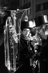 trumpet(0.0), saxophone(0.0), jazz(0.0), musician(1.0), tuba(1.0), musical instrument(1.0), music(1.0), monochrome photography(1.0), monochrome(1.0), brass instrument(1.0), black-and-white(1.0), black(1.0),