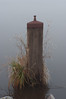 Bollard surrounded with fog by Ger@rds