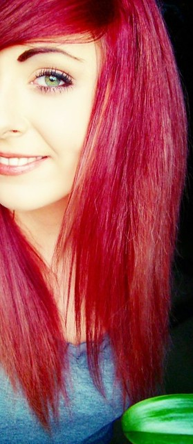 Bibi Barbaric red hair and smile