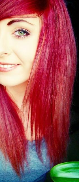 Bibi Barbaric red hair and smile