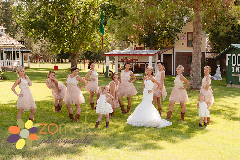 A large wedding party take a sassy pose at the reception location before the wedding ceremony.