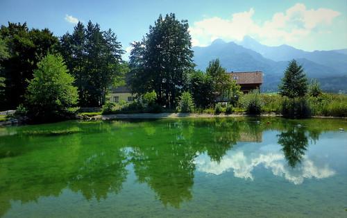 stagno austria carinzia riflessi acqua nuvole blu skiappa panasonic lumix estate gita