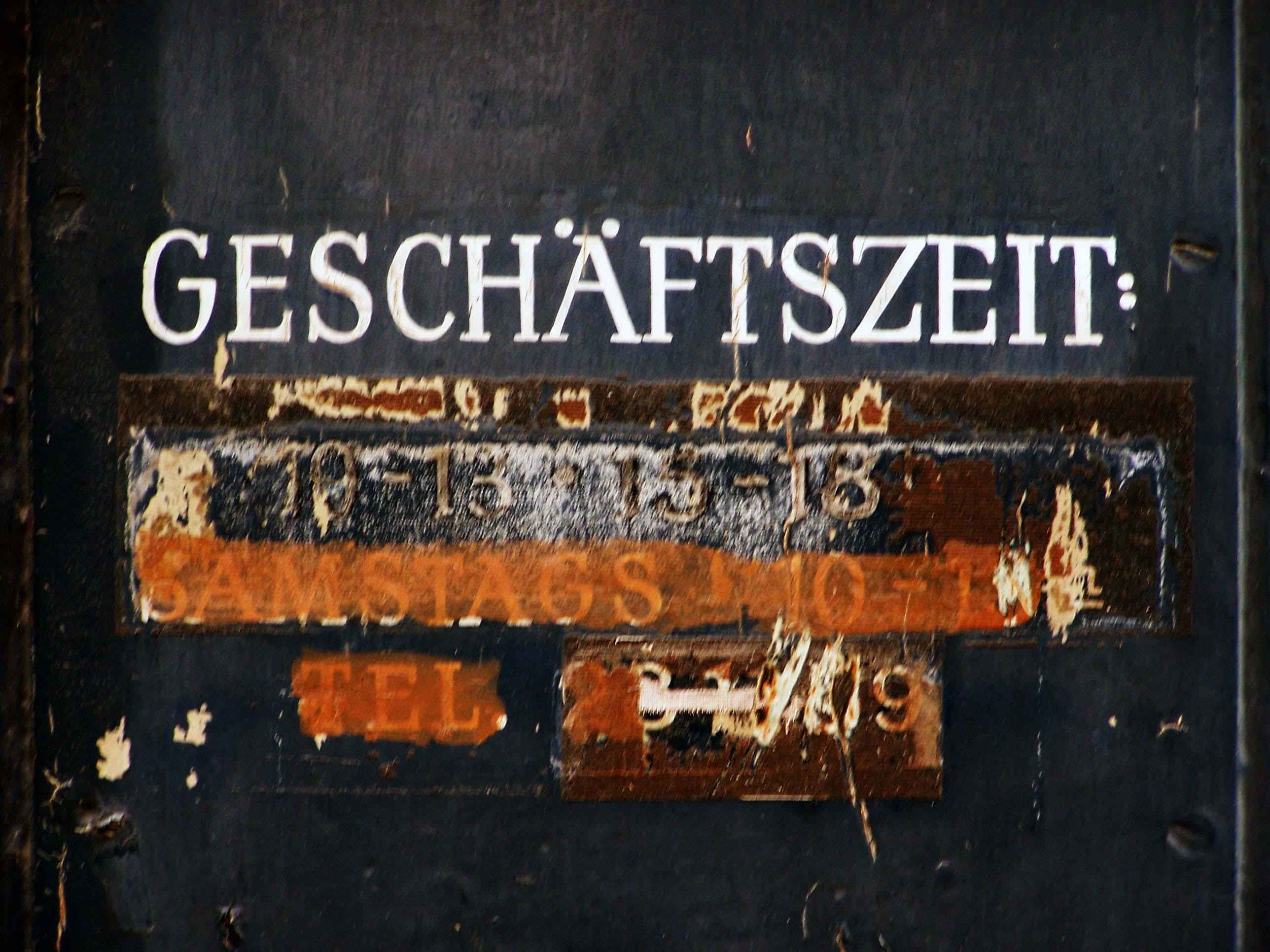 Türschild Geschäftszeit Antiquariat Hauser, Schellingstraße 17, München
