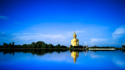 travel sky sculpture tree tourism nature face field statue architecture landscape asian thailand temple gold golden back big asia rice outdoor buddha background buddhist traditional religion culture buddhism icon thai meditation wat th filed largest tambonphaichamsin changwatangthong