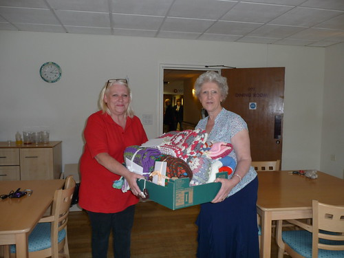 A member of Staff receiving the Blankets (10).
