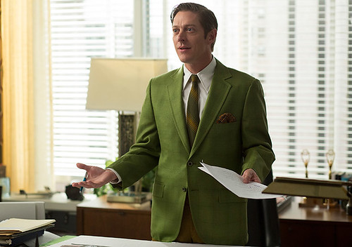 Ted Chaough in a green blazer standing behind a desk