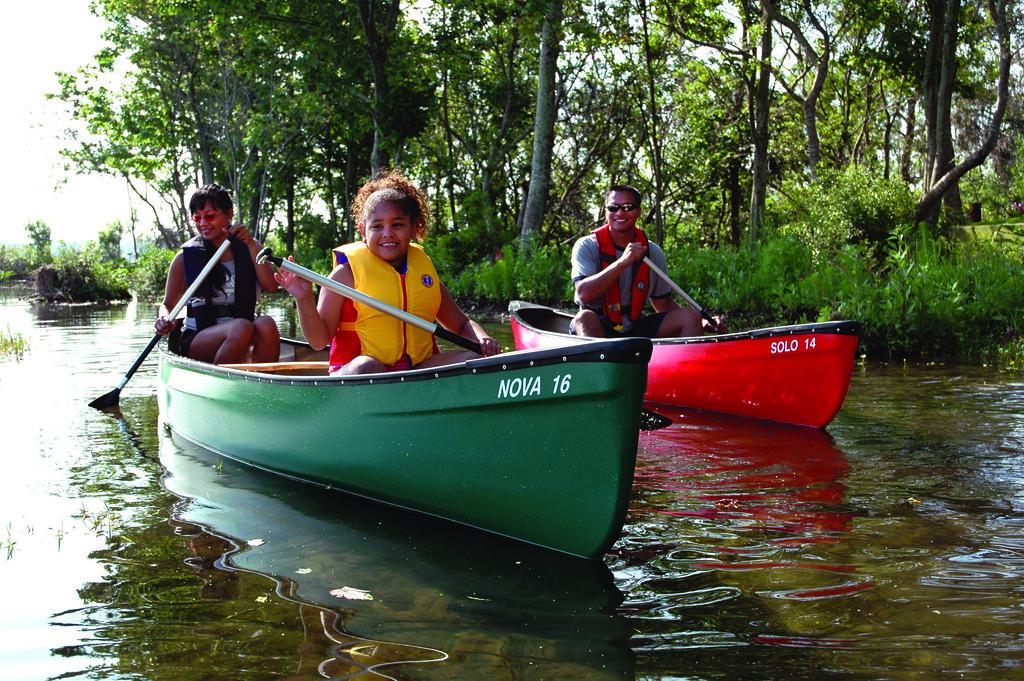 family on kayaks