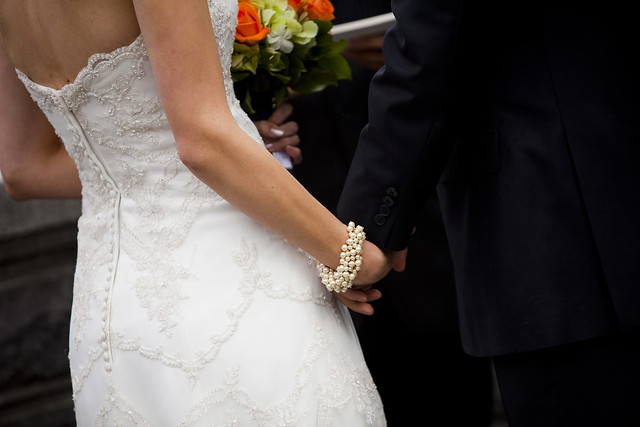 KateRussWedding_holding hands_phot by Augie Chang