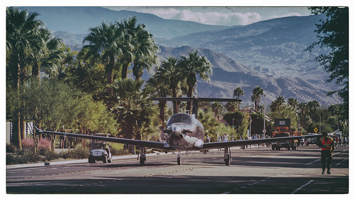 road street usa mountains smiling plane nikon driving desert palmsprings parade palmtrees coachellavalley unusual d200 hss riversidecounty aviationexpo sliderssunday hbmike2000 palmspringsaviationexpo planedrivingdownroad