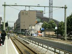 junction(0.0), public transport(0.0), lane(0.0), rolling stock(0.0), overpass(0.0), skyway(0.0), train station(1.0), metropolitan area(1.0), vehicle(1.0), train(1.0), transport(1.0), rail transport(1.0), track(1.0), rapid transit(1.0),