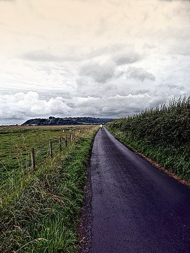 Graham heading along lane across Meathop Marsh. | by simeonorme