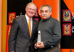 President Burns Hargis presents Moh'd Bilbeisi, Professor of Architecture in the College of Engineering, Architecture & Technology with the Eminent Faculty Award, which recognizes the highest level of scholarly achievement at OSU.