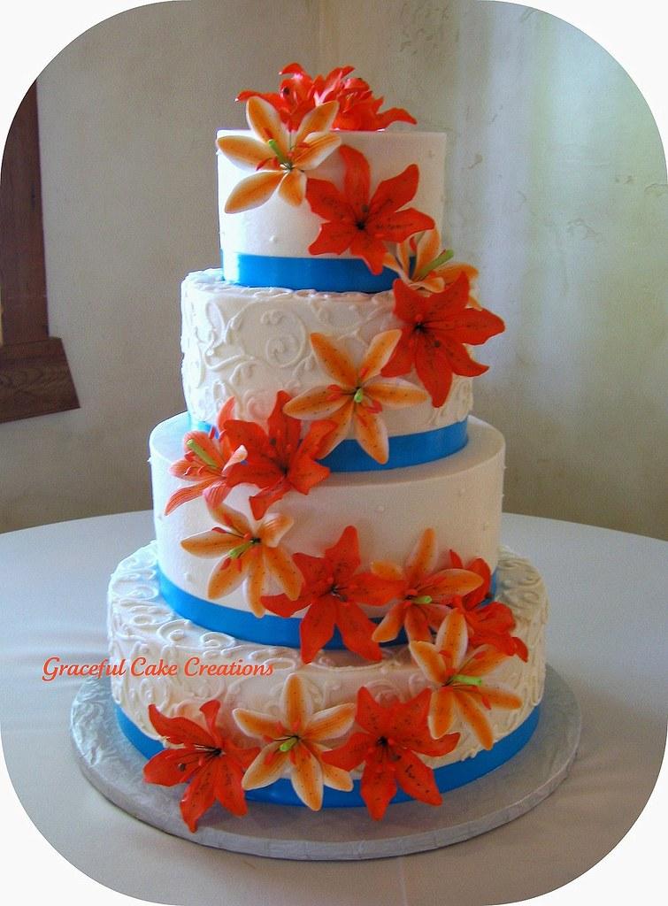 Tropical Wedding Cake with Orange Tiger Lilies and Malibu Blue ...