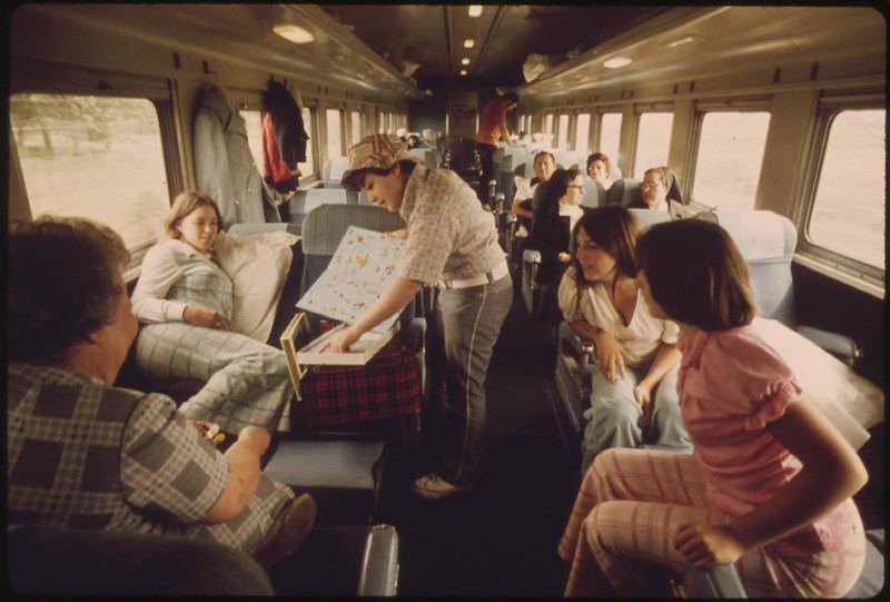 Regular passenger car filled with travelers on the Empire Builder enroute from Chicago to East Glacier Park, Montana, and Seattle, Washington, June 1974