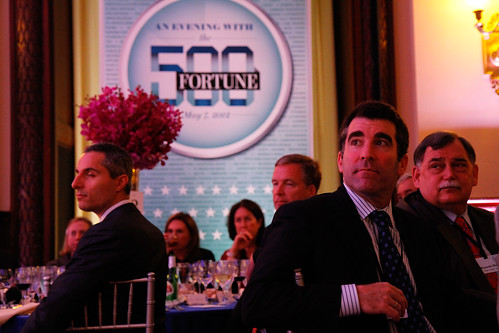 An Evening with the Fortune 500, people sitting at event tables.
