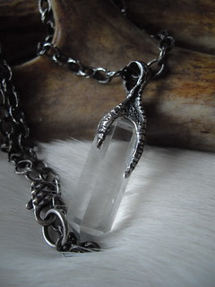 sterling silver claw and crystal quartz point necklace