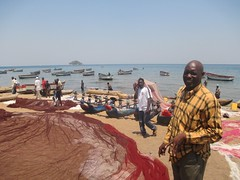 Nguwo village committee chairperson Ibrahim Kachinga on the shores of Lake Malawi. And for the past five years the village committee has been going to local gatherings to educate residents about the need to protect the lake. Credit: Mabvuto Banda/IPS