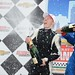 Mike Conway sprays champagne with Justin Wilson