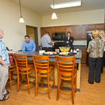 c06 -- JULY: Staff tour a kitchen during an open house for The Gates student apartment buildings.
