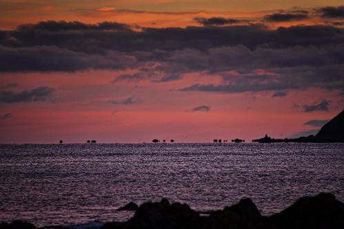 rock sunrise island bay north nz wellington mirage titahi