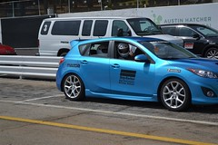 race car, automobile, automotive exterior, family car, vehicle, automotive design, mazda, subcompact car, bumper, mazdaspeed3, land vehicle,