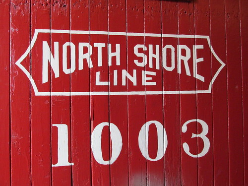 Chicago, North Shore And Milwaukee Railroad stencil markings up close on wooden cupola caboose # 1003.  The Illinois Railway Museum.  Union Illinois.  saturday, May 18th, 2013. by Eddie from Chicago