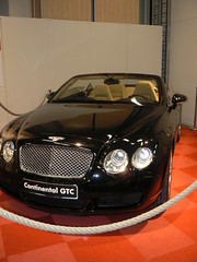 bentley continental flying spur(0.0), automobile(1.0), automotive exterior(1.0), bentley continental supersports(1.0), executive car(1.0), wheel(1.0), vehicle(1.0), automotive design(1.0), bentley continental gtc(1.0), auto show(1.0), bentley continental gt(1.0), bumper(1.0), land vehicle(1.0), luxury vehicle(1.0), bentley(1.0), convertible(1.0), supercar(1.0),