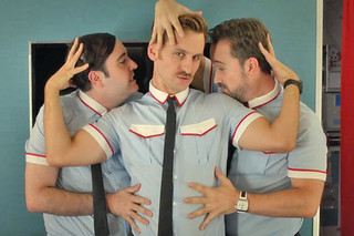 Three male flight attendants stroke eachother