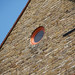 Small photo of Round window in Neal's Yard