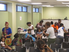 Moms, sisters, aunts, and neighbors continued braiding hair long past the end of the event.