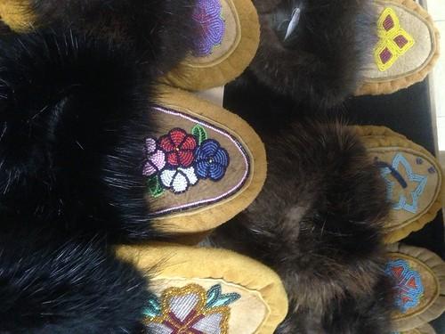 Ahtna & Tanana Women Make Handcrafted Moosehide Slippers -- Like Women In Scotland Knit Wool Sweaters
