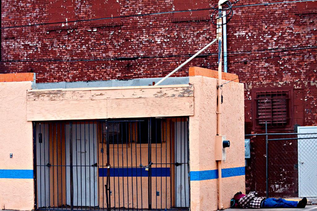 Man-sleeping-ground-near-East-Paisano--El-Paso