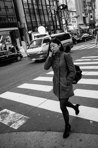 Woman crossing the street at Shibuya. Tokyo 2012
