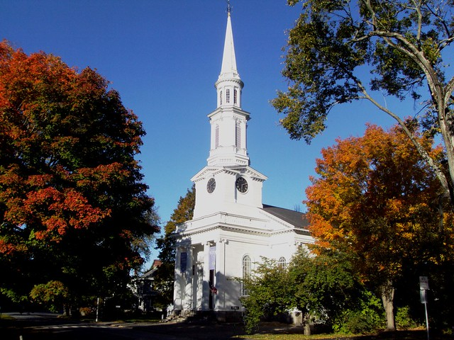 Autumn leaves and Puritan church on Lexington Green Mass. from Flickr via Wylio