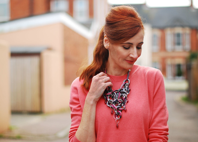 Red hair, coral sweater & statement necklace